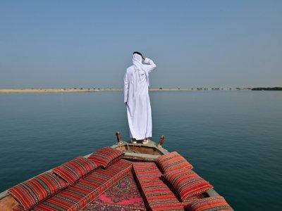 Vue d'une ferme perlière depuis un bateau traditionnel près de Ras al-Khaimah, aux Emirats, le 31 octobre 2019 - GIUSEPPE CACACE [AFP]