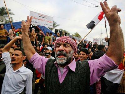 Des Irakiens manifestent contre le gouvernement dans la capitale Bagdad, le 6 décembre 2019 - AHMAD AL-RUBAYE [AFP]