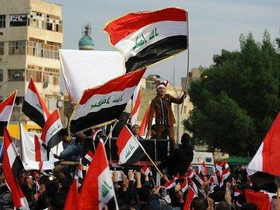 Des Irakiens manifestent sur la place Tahrir à Bagdad, le 6 décembre 2019 - AHMAD AL-RUBAYE [AFP]