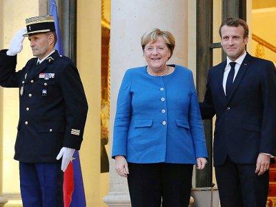 Le président Emmanuel Macron et la chancelière allemande Angela Merkel sur le perron de l'Elysée, le 13 octobre 2019 à Paris    ludovic MARIN [AFP]