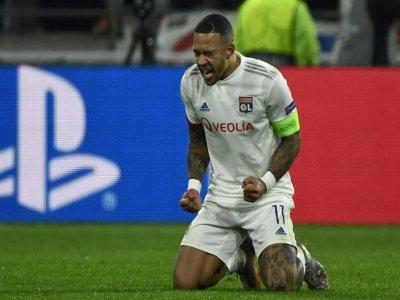 La joie rageuse de l'attaquant de Lyon Memphis Depay, auteur du but la qualification en 8e de la C1, face à Leipzig, le 10 décembre 2019 à Décines-Charpieu    JEFF PACHOUD [AFP]
