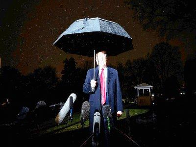 Le président américain Donald Trump répond aux questions des journalistes depuis les jardins de la Maison Blanche le 10 décembre 2019    JIM WATSON [AFP]