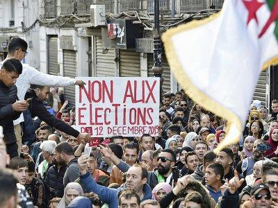 Des manifestants antigouvernementaux à Alger le 10 décembre 2019    RYAD KRAMDI [AFP]