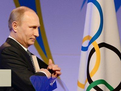 Le président russe Vladimir Poutine lors d'une réception à Sotchi, à la veille de l'ouverture des Jeux olympiques d'hiver de 2014, le 6 février 2014 - Andrej ISAKOVIC [AFP/Archives]