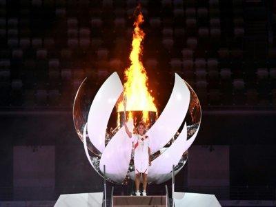 La joueuse de tennis japonaise Naomi Osaka, après avoir allumé la vasque olympique, le 23 juillet 2021 au Stade Olympique à Tokyo    Andrej ISAKOVIC [AFP]