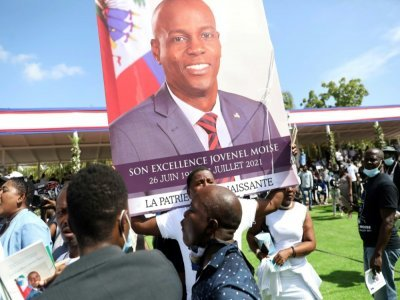 Des personnes rassemblées aux obsèques de Jovenel Moïse à Cap-Haïtien, en Haiti, le 23 juillet 2021    Valerie BAERISWYL [AFP]