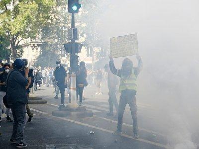 Heurts en marge d'une mobilisation contre le pass sanitaire à Paris, le 24 juillet 2021    Sameer Al-DOUMY [AFP]