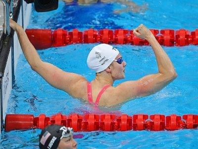 La Française Marie Wattel après sa victoire en demi-finales du 100 m papillon, le 25 juillet 2021 aux Jeux olympiques de Tokyo - Oli SCARFF [AFP]