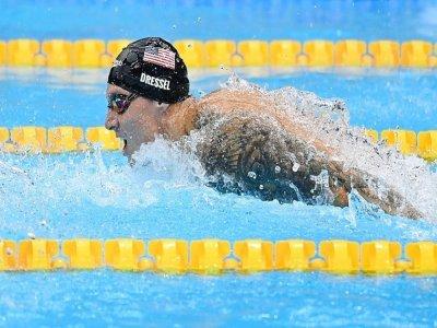 L'Américain Caeleb Dressel lors du 100 m papillon dans lequel il a été sacré champion olympique aux Jeux de Tokyo en signant un nouveau record du monde, le 31 juillet 2021    Jonathan NACKSTRAND [AFP]
