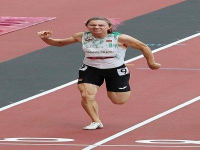 L'athlète bélarusse Krystsina Tsimanouskaya lors des séries du 100 m dames des Jeux olympiques de Tokyo, le 30 juillet 2021 - Giuseppe CACACE [AFP/Archives]