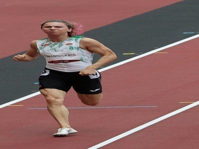 Krystsina Tsimanouskaya lors des séries du 100 m aux JO de Tokyo, le 2 août 2021    Giuseppe CACACE [AFP/Archives]