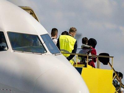 Des réfugiés afghans, évacués de Kaboul vers Dubaï, arrivent à l'aéroport de Copenhague le 22 août 2021    Mads Claus Rasmussen [Ritzau Scanpix/AFP]