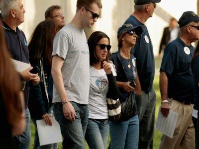 Des familles des victimes du World Trade Center se recueillent sur le site de Ground Zero pour le 10e anniversaire des attentats, le 11 septembre 2011 à New York    CHIP SOMODEVILLA [Getty/AFP/Archives]
