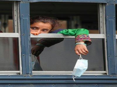 Une jeune réfugiée afghane, sur la base aérienne américaine de Ramstein, en Allemagne, le 26 août 2021    Armando BABANI [AFP]
