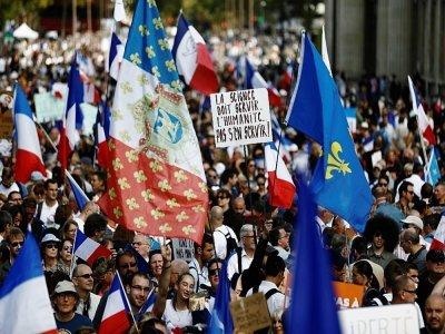"""Manifestation anti pass sanitaire organisée à Paris par le mouvement """"Les Patriotes"""" de l'ex-membre du Front national Florian Philippot, le 28 août 2021    Sameer Al-DOUMY [AFP]"""
