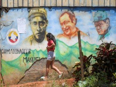 photo d'une fresque murale représentant l'ancien leader de la guerrilla des FARC-EP, Marulanda, dans les montagnes de la municipalité de El Patia, dans la région de Cauca en colombie, le 5 mai 2021    Raul ARBOLEDA [AFP]