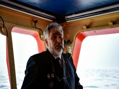 """Dmitri Loboussov, le capitaine du brise-glace russe """"50 let Pobedy"""" (50 ans de la Victoire), dans l'océan Arctique, le 18 août 2021    Ekaterina ANISIMOVA [AFP/Archives]"""
