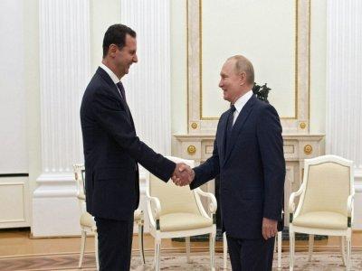 Le président russe Vladimir Poutine reçoit son homologue syrien Bachar al-Assad au Kremlin le 13 septembre 2021    Mikhail KLIMENTYEV [SPUTNIK/AFP]