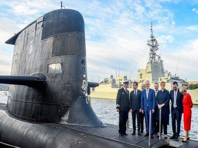 Le président français Emmanuel Macron et le Premier ministre australien de l'époque Malcolm Turnbull visitent un sous-marin australien à Sydney, le 2 mai 2018 - BRENDAN ESPOSITO [POOL/AFP/Archives]